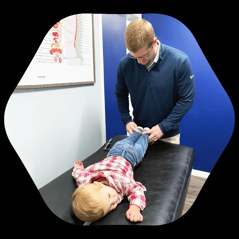 Chiropractor Britt IA Dr. Brady Wilson Adjusting Patient
